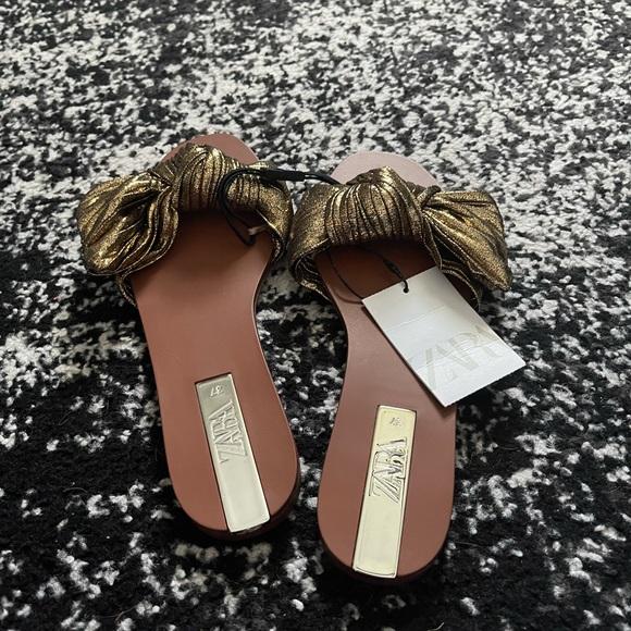 Gold sandals. Never worn.